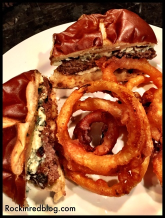Black and blue burger with onion rings