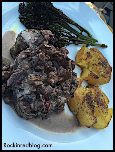 steak with mushroom sauce potatoes and brocolini